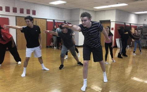 Senior Jack Dalrymple as he leads the Sister Act cast in their dance routine.