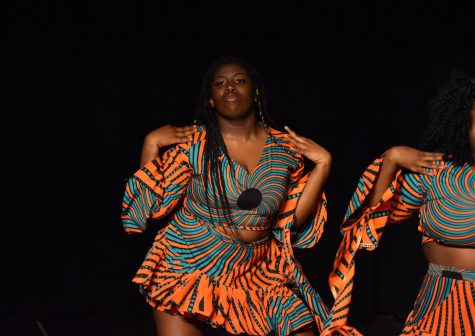 Kadijah Janneh performs a cultural Sierra Leon dance in traditional clothing during Heritage Night in 2019.