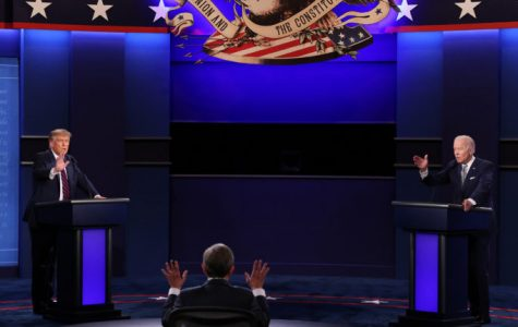 Moderator Chris Wallace holding his hands up in protest of the candidates talking over one another, a common theme throughout  the night.