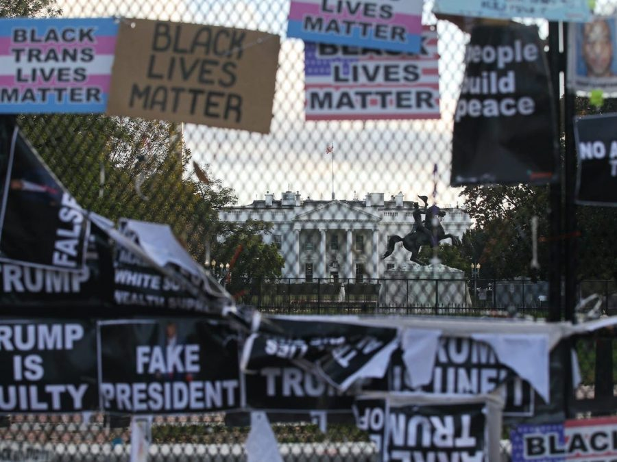 The+fence+outside+the+White+House+is+covered+with+posters+and+signs+on+Nov.+15+after+celebrations+over+Biden%E2%80%99s+victory+and+protests+over+Trump%E2%80%99s+recent+actions.+