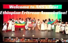 "Seniors Haleluya Worku and Kidist Bekele present during the Ethiopian-Eritrean Association's interest meeting. ""My favorite part of the first meeting was when everyone started talking about what they love about Ethiopia and Eritrea and it felt like we were this one big friend group,"" Worku said."