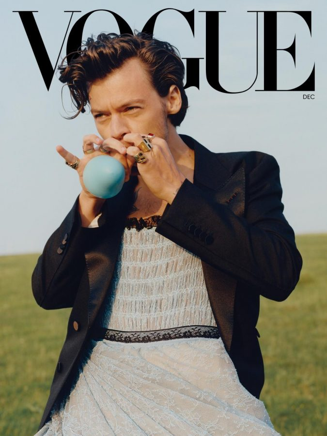 Harry Styles in a dress on the December cover of Vogue. Styles is the first man to cover American Vogue solo.