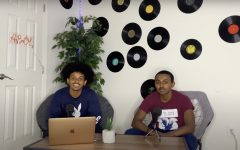"""Michael Bekele and Yoftahe Hailu sit at their podcast recording setup. """"""""I spent a lot less money on mics and equipment, which was another reason I chose podcasting over Youtube,"""" Bekele said."""