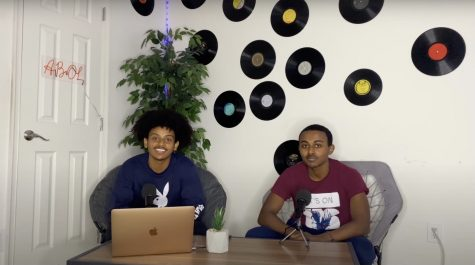 "Michael Bekele and Yoftahe Hailu sit at their podcast recording setup. """"I spent a lot less money on mics and equipment, which was another reason I chose podcasting over Youtube,"" Bekele said."