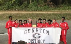 Boys cross country celebrates a district championship in 2018