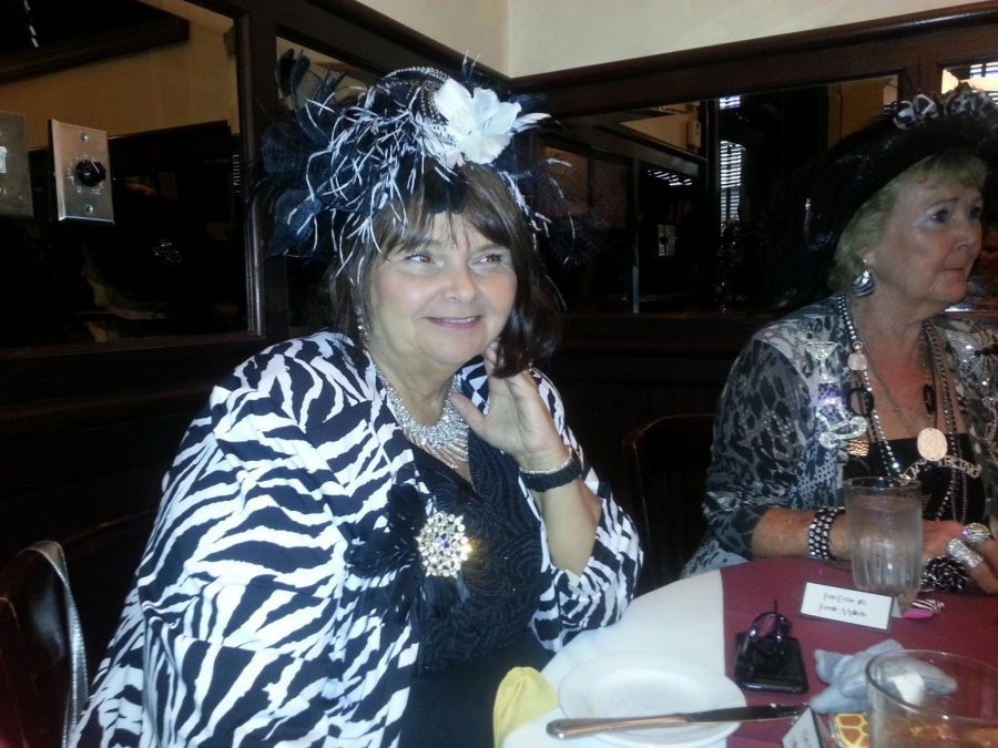 Mary Wolfe sits at the table of a Black and Bling event.