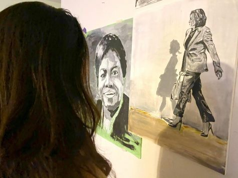 In honor of Black History Month, junior Holly Waldridge admires her mother's paintings of important black figures including Kamala Harris, Ruby Bridges and Mary McLeod Bethune.