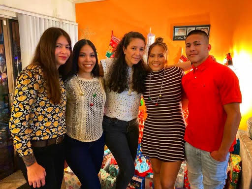 Senior Walter Aponte (far right) poses for a picture with his family during Christmas.