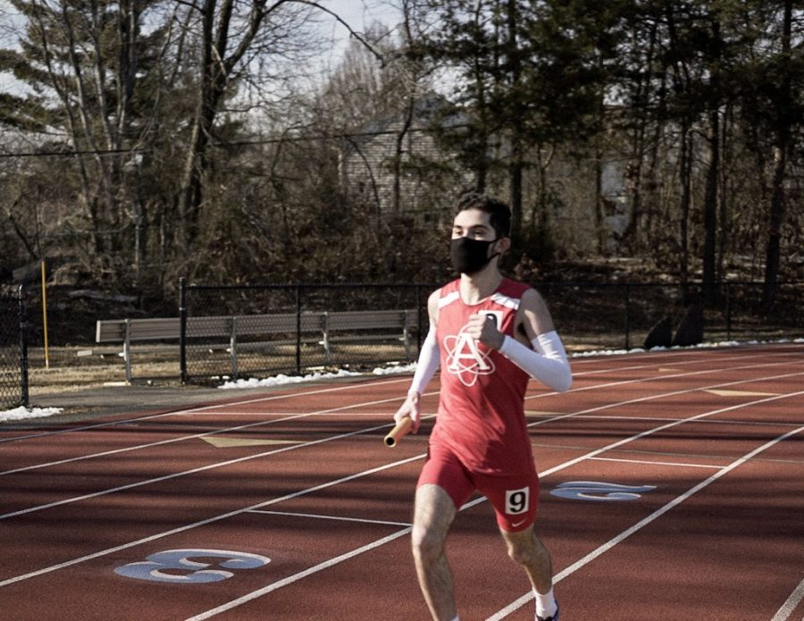 Senior+Mousa+Ayoub+runs+his+leg+in+the+boys+4x800+relay+at+the+Regional+Championship+for+the+winter+track+season+at+West+Springfield