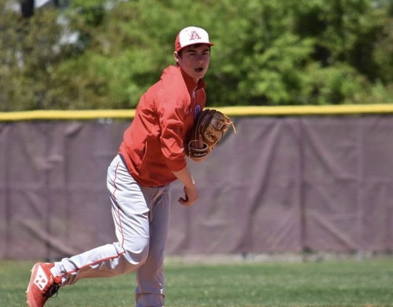 Senior TJ Hutnan practices his pitching during the preseason earlier this year