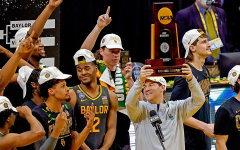 Baylor head coach Scott Drew hoists the National Championship Trophy after defeating #1 seed Gonzaga.