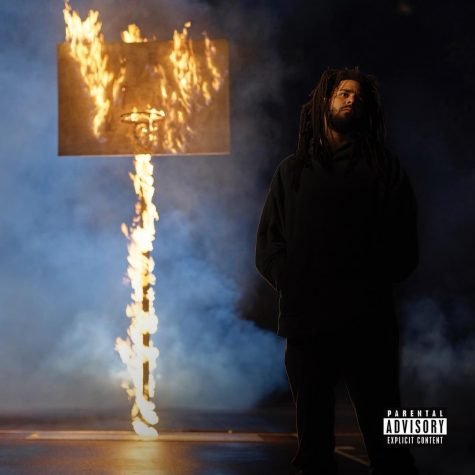 "J. Cole poses on the cover of his new album ""The-Off-Season."""