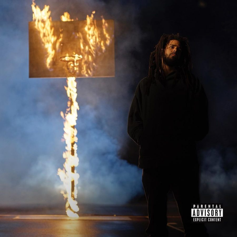 J. Cole poses on the cover of his new album