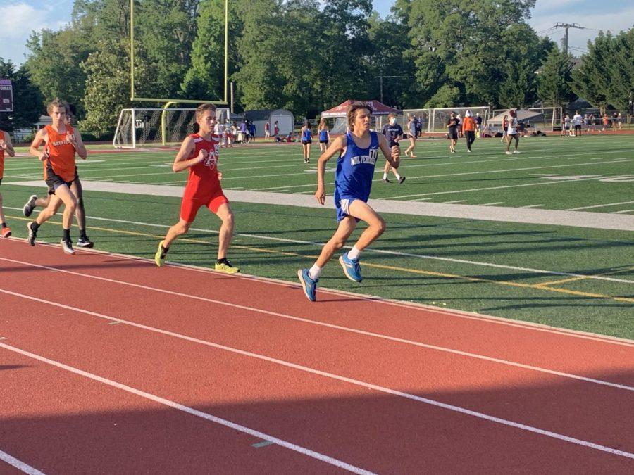 Senior Bennett Stenberg  (middle) runs the 1600 during the district championship meet at Mount Vernon.
