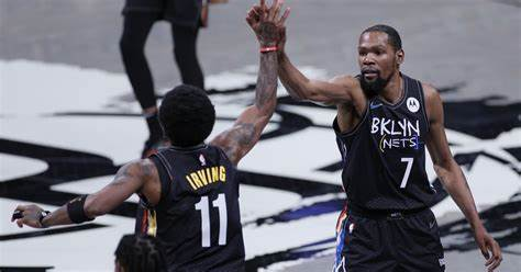 Brookyln Nets superstars Kyrie Irving and Kevin Durant celebrate after making a great play.