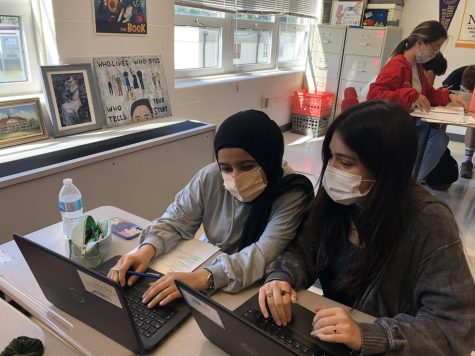 Seniors Dina Dib and Helin Yousif work together on peer editing their personal essays and providing each other with feedback and criticism before it's turned in to be graded by their teacher Sasha Duran-Russel.