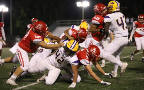 Senior running back Khalil Herbert fights for additional yards after contact against Lake Braddock