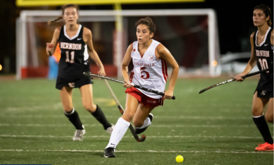 Sandy Karabelas dribbles towards the goal against Herndon during their Sept. 8 game. The Atoms lost to the Hornets (3-1) in an overtime thriller.