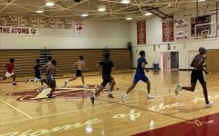 Varsity basketball players run sprints in the gym to prepare for the upcoming season.