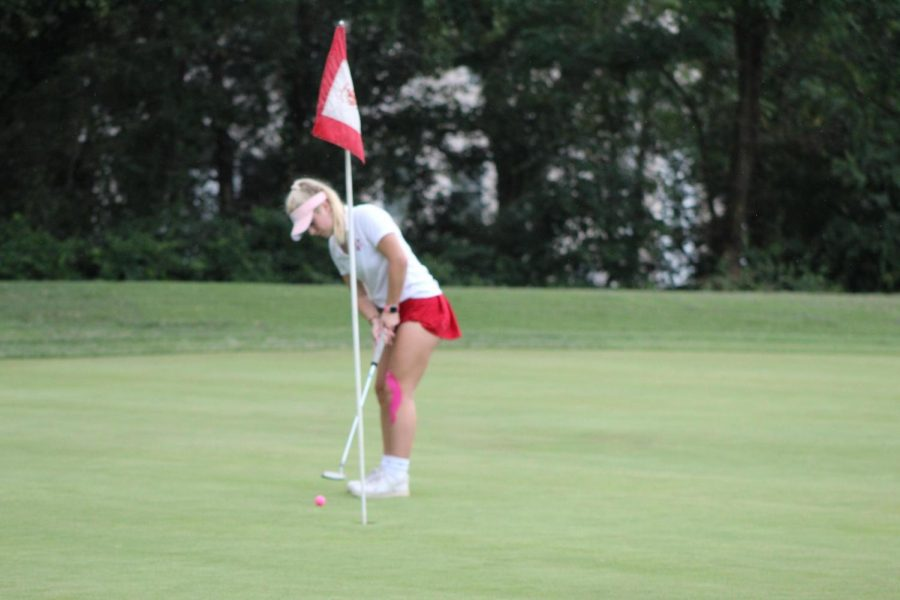 Senior Kate Chrestman puts in for par on the 4th hole of Pinecrest Golf Course