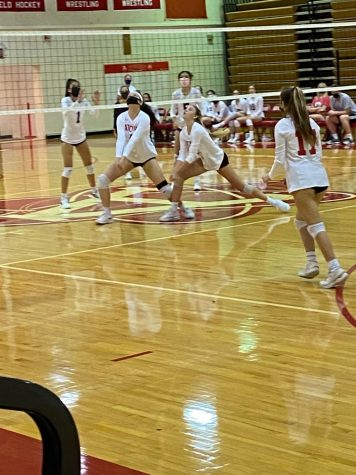 AHS varsity volleyball warms up for their upcoming match