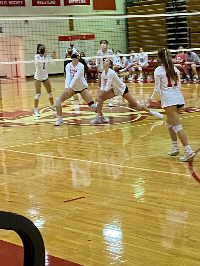 AHS+varsity+volleyball+warms+up+for+their+upcoming+match