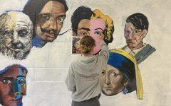 Artists start mural renovations